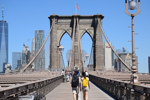 Tourists walking across the Brooklyn Bridge